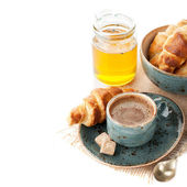 Coffee, croissants and honey for a delicious breakfast — Stock Photo