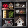 Christmas decorations set: antique clocks, birdhouse, Santa's sleigh and Christmas toys — Stock Photo