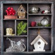 Christmas decorations set: antique clocks, birdhouse, Santa's sleigh and Christmas toys in an old wooden box — Stock Photo