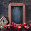 Stock Photo: Christmas Decoration: wooden birdhouse and chalk board in vintage style