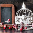 Christmas set: vintage bird cage and chalk board — Stock Photo