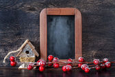 Christmas Decoration: wooden birdhouse and chalk board in vintage style — Stock Photo