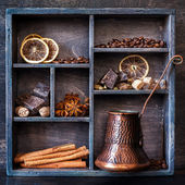 Spices, coffee and chocolate in a vintage box — Stock Photo
