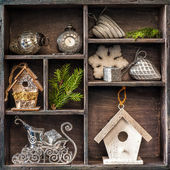 Antique clock, sleigh Santa Claus and birdhouse. Christmas toys in а wooden box — Stock Photo