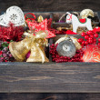 Wooden box with Christmas toys and decorations — Stock Photo