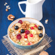 Stock Photo: Muesli (granola) with berries, walnuts and milk