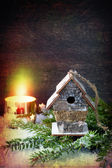 Christmas Decorations: birdhouse and a burning candle. Retro Style — Stock Photo