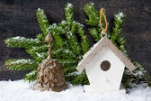 Christmas tree Decorations: birdhouse and the bell on the vintage background — Stock Photo