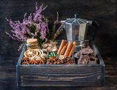 Сoffee beans, chocolate, spices and honey in a wooden box. — Stock Photo