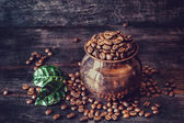 Coffee grains with green leaves — Stock Photo
