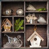 Antique clock, sleigh Santa Claus and birdhouse. — Stock Photo