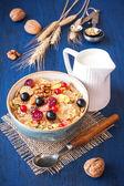 Muesli (granola) with berries, walnuts and milk — Stock Photo