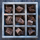 Chocolate in an old wooden box — Stock Photo