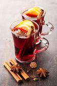 Hot wine (mulled wine) with spices — Stock Photo