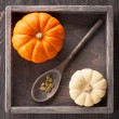 Pumpkins in a vintage wooden box — Stock Photo