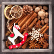 Christmas spices and Christmas toys in vintage wooden box — Stock Photo