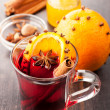 Hot Christmas drink (mulled wine) with spices — Stock Photo