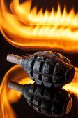 Grenade in flames — Stock Photo