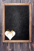 Hearts and chalk board — Stock Photo