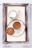 Cup of espresso with milk and oat cookies — Stock Photo
