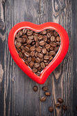 Coffee beans and bowl of heart — Stock Photo