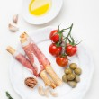 Prosciutto ham grisiini breadsticks — Stock Photo #41800425