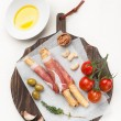 Prosciutto ham grisiini breadsticks — Stock Photo #41800429