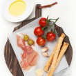 Prosciutto ham grisiini breadsticks — Stock Photo #41800459