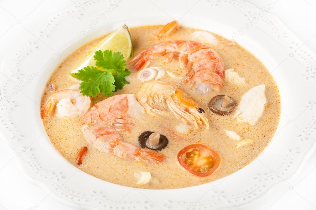 White ceramic pan with spicy thai soup tom yam with coconut milk