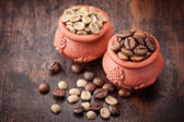 Green coffee.  Roasted coffee beans. Different types of coffee on wooden background. — Stock Photo