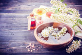 Spa aromatherapy set. Flowers, massage oil, sea salt — Stock Photo