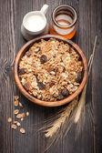 Muesli with milk and honey. Healthy breakfast — Stock Photo