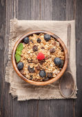 Homemade granola cereal with blueberries and raspberries — Stock Photo