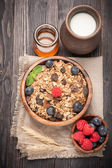 Healthy breakfast of granola cereal with honey, blueberries and raspberries — Stock Photo
