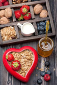 Granola muesli with berries, honey, nuts and milk. Concept of healthy food — Stock Photo