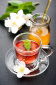 Herbal tea with mint, flowers jasmine and honey — Stock Photo