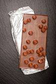 Chocolate with nuts on dark background. Chocolate background — 图库照片