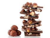 Chocolate with nuts on white background — Stock Photo