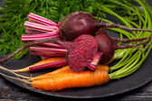 Beets and carrots with leaves closeup — Stock Photo