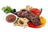 Grilled meat and grilled vegetables — Stock Photo