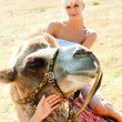 A girl riding a camel — Stock Photo