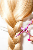 Cutting the pigtail — Stock Photo