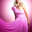 Постер, плакат: Beautiful blonde in pink with a flower Barbie doll