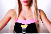 Beautiful blonde in a bar — Stock Photo