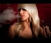 Woman smokes a hookah — Stock Photo