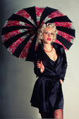 Pin-up girl. American style. Women in Black Coat with Umbrella — Stock Photo