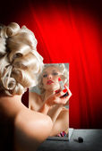 Retro Woman Applying Lipstick in Mirror — Stock Photo