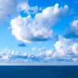 Sea, blue sky and clouds - Stock Photo