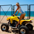 Beautiful girl on a quad — Stock Photo