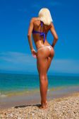 A woman sunbathes on a beach — Stock Photo